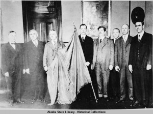 Governor Parks and seven men with Alaska flag