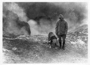 Fr. Hubbard and dog wearing gas masks