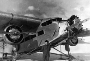 Noel Wien standing in front of his Ford Tri-Motor airplane, 1939. UAF-2010-50-365, Wien Family Papers, University of Alaska Fairbanks Archives.