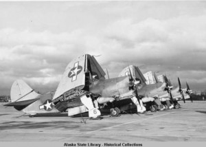 Military airplanes on runway with wings folded up, Dutch Harbor, Alaska, circa 1944. ASL-P338-0420, H. Marion Thornton Photograph Collection, Alaska State Library-Historical Collections.