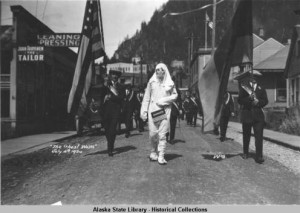 Ghost walking in parade, July 4th, 1924, Juneau, Alaska. ASL-P87-1207, Winter and Pond Photographs, Alaska State Library-Historical Collections.