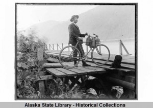 Man with a bicycle on the dock at Yakutat, Alaska, circa 1920. ASL-P55-293, Fhoki Kayamori Photographs, Alaska State Library Historical Collections.