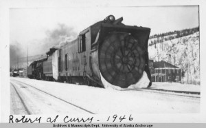 Locomotive with rotary snow clearing blade on the front at Curry, Alaska, 1946. UAA-hmc-0569-5c, Elmer Williams photographs, Archives & Special Collections, Consortium Library, University of Alaska Anchorage.