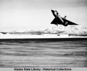 Fighter jet on takeoff at Elmendorf Air Force Base, Anchorage, Alaska.  ASL-P553-03, Oliver Middaugh Photograph Collection, Alaska State Library-Historical Collections.
