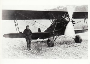 "Merle ""Mudhole"" Smith poses with his Stearman C2B biplane. #95-46-54, courtesy of the Cordova Museum, Cordova, Alaska."