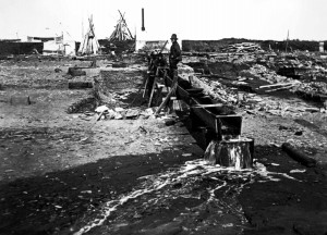 """July 21st, 1900: """"I went to bed at 7:30 A.M. and slept till 2PM. Ed moved the sluice boxes and we will start another fit tonight. Our pump is lots of trouble. I think we have mastered it though."""" Photo by Wilfred McDaniel from the Carrie M. McLain Memorial Museum Archives"""