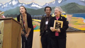 Jane Lindsey, Ron Inouye, and Marie Darlin accept the Esther Billman Certificate of Excellence for Juneau's Empty Chair Project.
