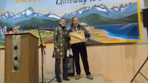 AHS President Katie Ringsmuth presents the Beaver Log to Karen Brewster.