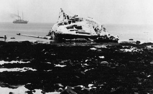 The wreck of the cod fishing schooner JOHN F. MILLER, just off Cape Pankov on Unimak Island with the SS DORA in the background. Photograph by John E. Thwaites, ca. 1908.