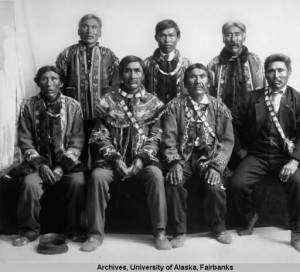 Group portrait at the first Tanana Chiefs Conference, 1915. Seated front, L to R: Chief Alexander of Tolovana, Chief Thomas of Nenana, Chief Evan of Koschakat, Chief Alexander William of Tanana. Standing at rear, L to R: Chief William of Tanana, Paul Williams of Tanana, and Chief Charlie of Minto. Albert Johnson Photograph Collection, University of Alaska Fairbanks.