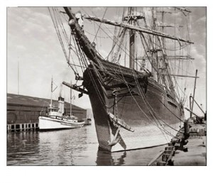 The CHARLES E. MOODY at the dock in Seattle ca. 1911. The anchor is visible against the hull as the vessel is unloaded and sitting high in the water. (Photograph courtesy Ted Hadfield.)