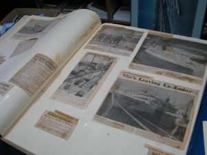 Deteriorating pages of the folio showing the history of the Port of Anchorage. (Photo by J P Goforth)