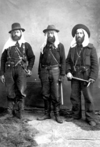 Alaska geologists Frank Schrader, J. Edward Spurr and Harold Goodrich pose in work clothes, 1896. USGS Photo Library.
