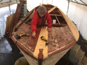 Restoring sailboat