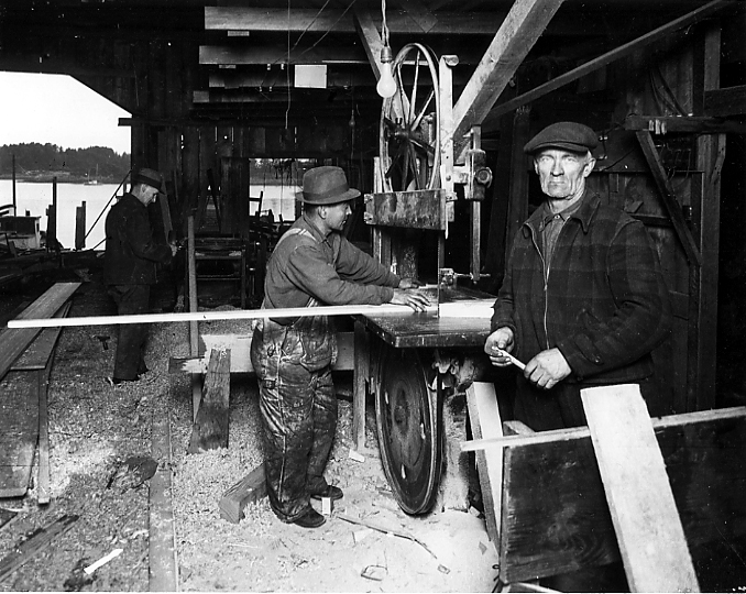 Andrew Hope at the bandsaw, probably at Scotty Jennings' boat shop, 1920s. Photo courtesy Sitka Historical Society collection.