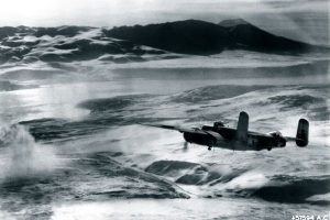 A B-25J from the Aleutians approaches Japanese targets in the Kuril Islands. (Army Air Force, 613ABW Hist. Office.)