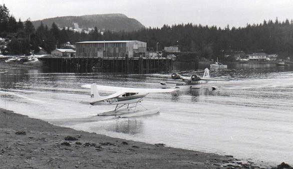 Glacier Bay Seafoods in Ouzinkie, Alaska, in the early 1970s, with a Kodiak Air Grumman Goose mail plane heading to the village beach. Photo by Tim Smith.